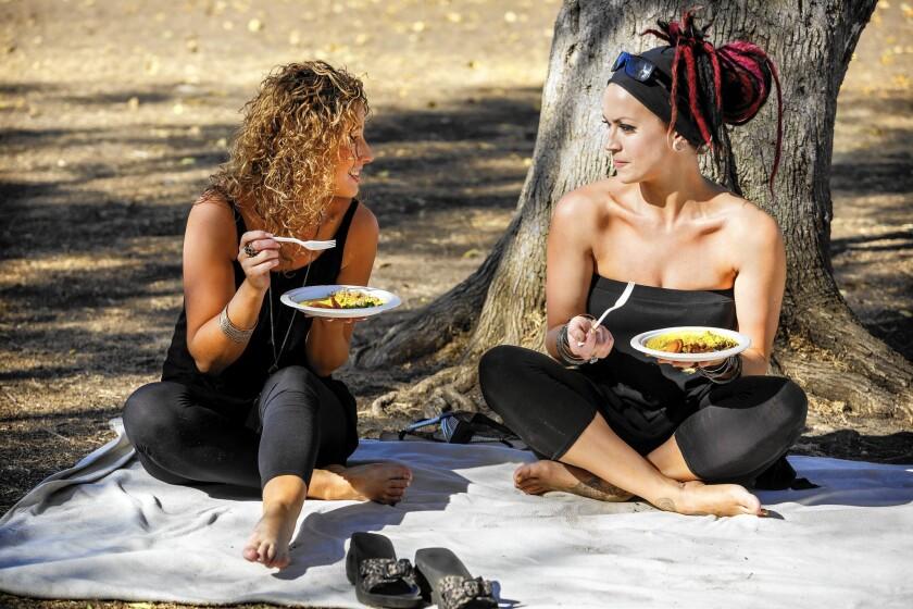 Kim O'Callaghan, left, and sister Tanya at a Vegan Thanksgiving Potluck at Rancho Park.