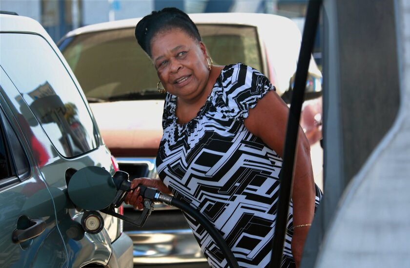 Glennetta Houston fills up at Ultra Gas on El Cajon Blvd. before heading to a doctor's appointment Tuesday morning. One of the cheaper gas prices around San Diego is an Ultra Gas station on El Cajon Blvd. at 33rd Street. It's a few cents cheaper than the Arco station on the next block. .
