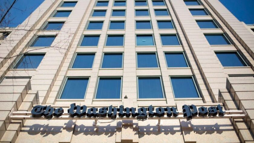"""Headquarters of the Washington Post, which has adopted """"Democracy Dies in Darkness"""" as its new motto."""