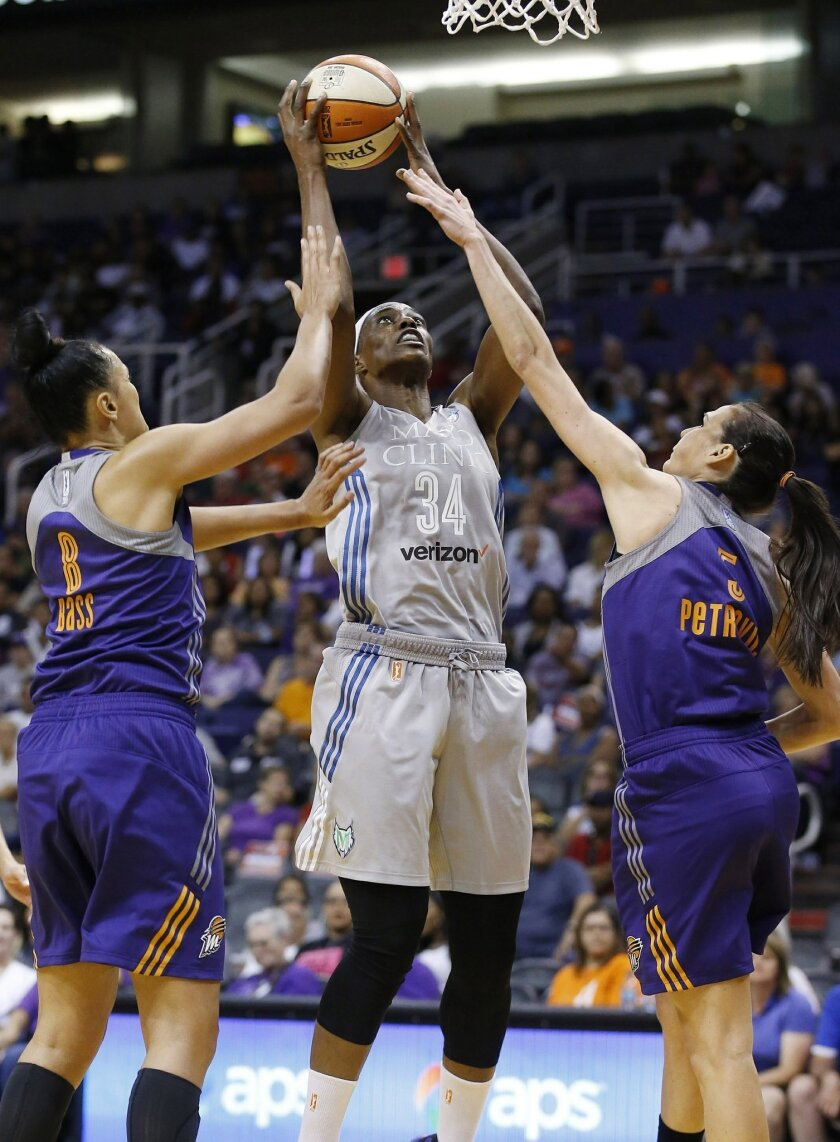Minnesota Lynx's Sylvia Fowles (34) shoots between Phoenix Mercury's Mistie Bass (8) and Sonja Petrovic, right, during the first half of a WNBA basketball game Wednesday, May 25, 2016, in Phoenix. (AP Photo/Ross D. Franklin)