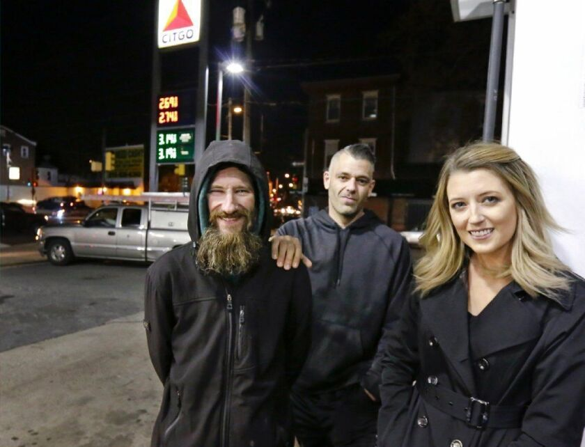 Kate McClure, right, and McClure's boyfriend Mark D'Amico, center, raised $400,000 for Johnny Bobbitt, but allegedly never gave him any of the money.