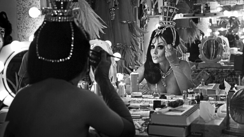 A Folies Bergere showgirl applies makeup before a 1970 performance. The revue ran for nearly 50 years at the Tropicana.