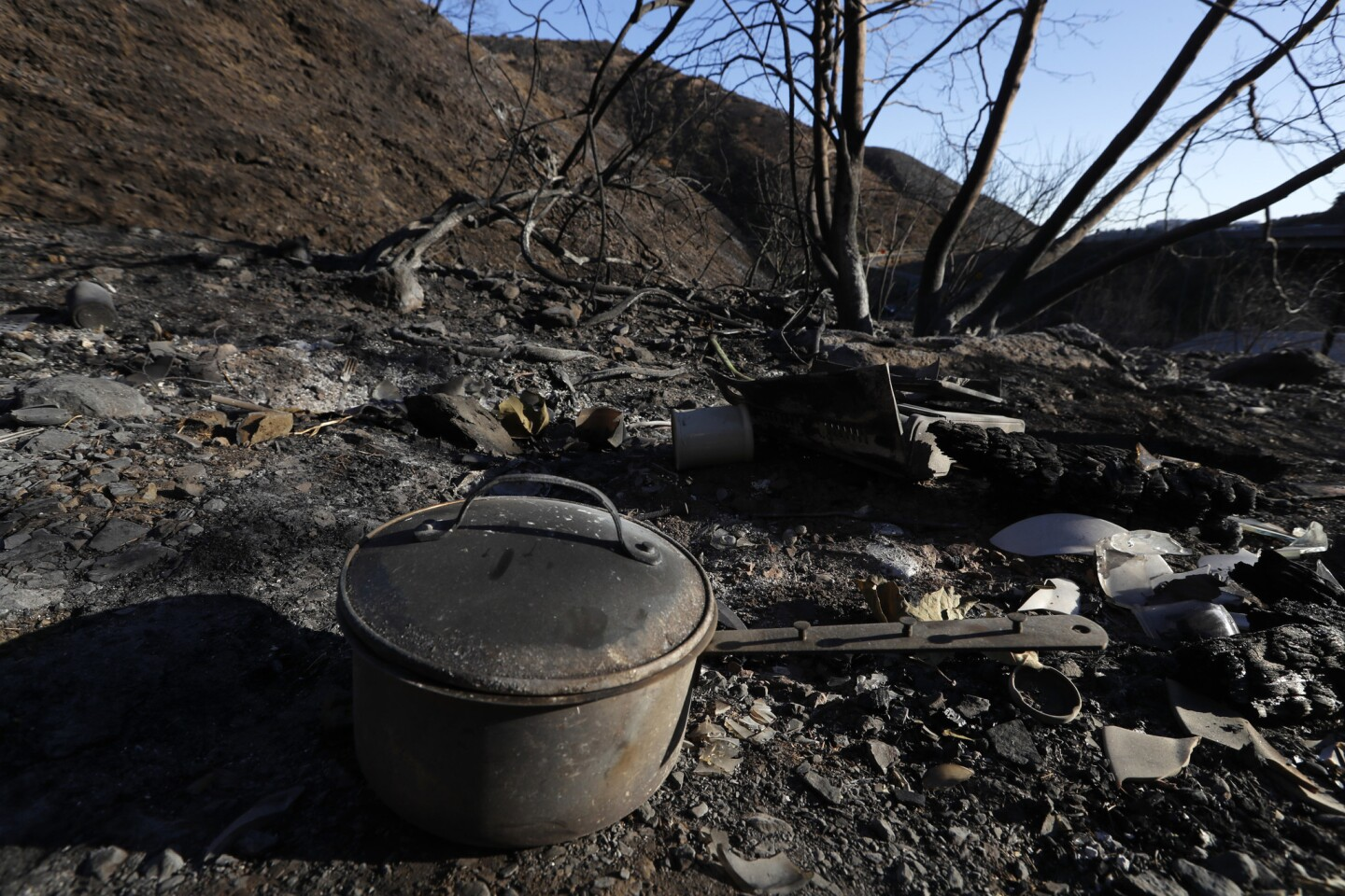 A scorched pot is among the few remnants of a homeless site where investigators believe the Skirball blaze, which destroyed more than 400 acres, started.