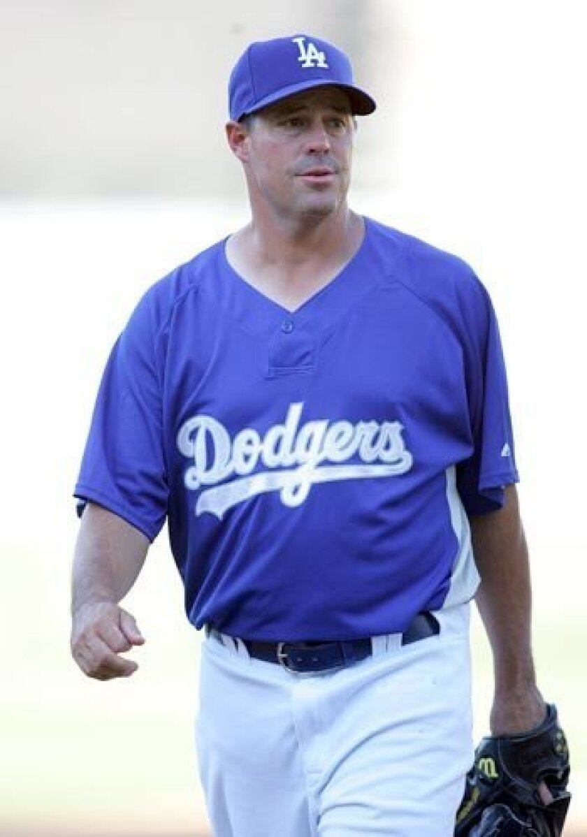 New Dodger Greg Maddux walks back to the dugout after batting practice Tuesday at Dodger Stadium.