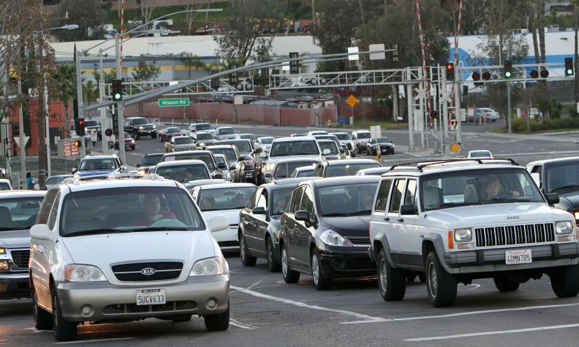 San Diego County transportation planners are considering charging tolls to encourage people not to drive in areas prone to traffic jams.