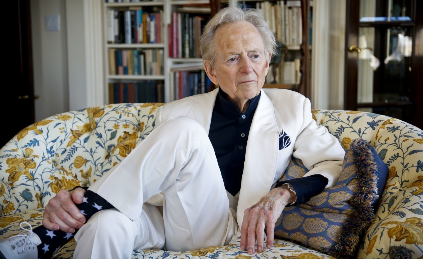 """Author and journalist Tom Wolfe is interviewed in July 2016 in his living room in New York about his book """"The Kingdom of Speech."""" Wolfe has died at age 87."""