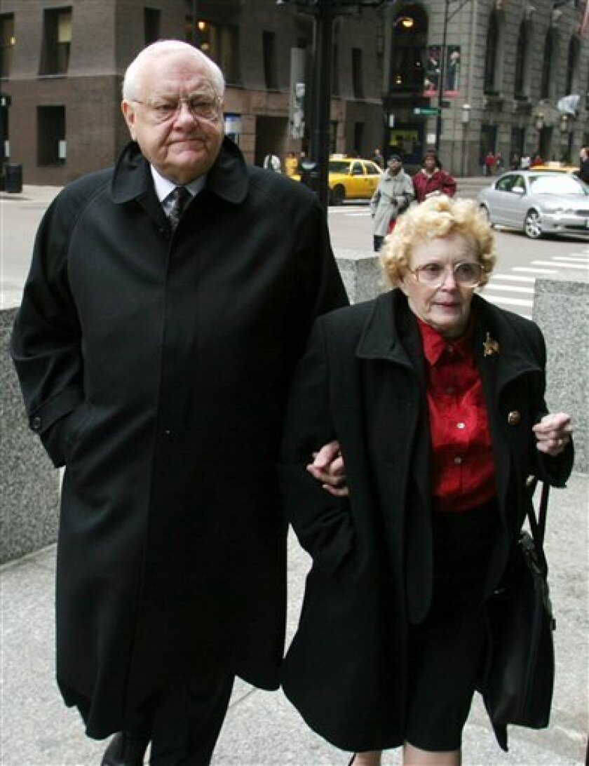 FILE - In this March 28, 2006 file photo, former Illinois Gov. George Ryan and his wife, Lura Lynn, arrive at Chicago's federal court. Attorneys for the now imprisoned former Illinois Governor are asking a federal judge to allow Ryan to visit his wife who is hospitalized in intensive care and may have hours to live. (AP Photo/Joshua Lott, File)