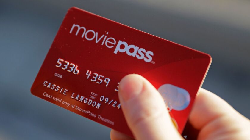 FILE - In this Jan. 30, 2018, file photo, Cassie Langdon holds her MoviePass card outside AMC Indian