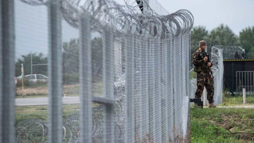 A Hungarian soldier patrols at the transit zone at Hungary's southern border with Serbia in Septembe