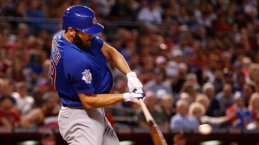 Cubs ace Jake Arrieta hits a two-run home run against the Diamondbacks during a game on April 10.