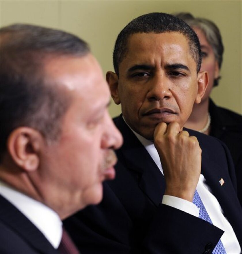 President Barack Obama listens as Turkish Prime Minister Recep Tayyip Erdogan speaks during their meeting in the Oval Office of the White House in Washington, Monday, Dec. 7, 2009. (AP Photo/Susan Walsh)