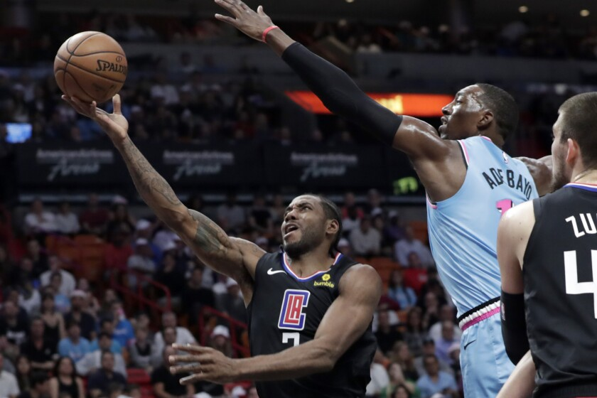 The Clippers' Kawhi Leonard drives against the Heat's Bam Adebayo during the first half Jan. 24, 2020.