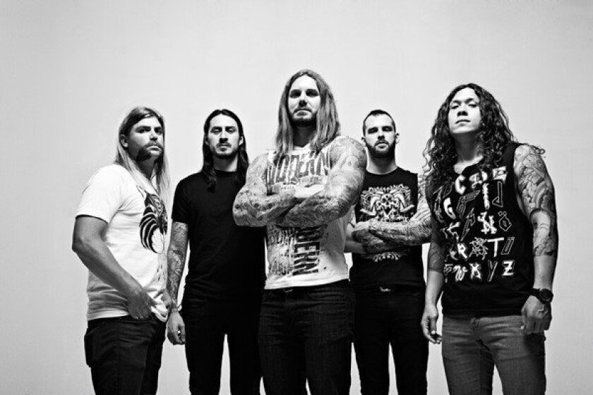 As I Lay Dying's Tim Lambesis, third from left, was arrested on Tuesday for allegedly hiring a hit man to kill his wife.