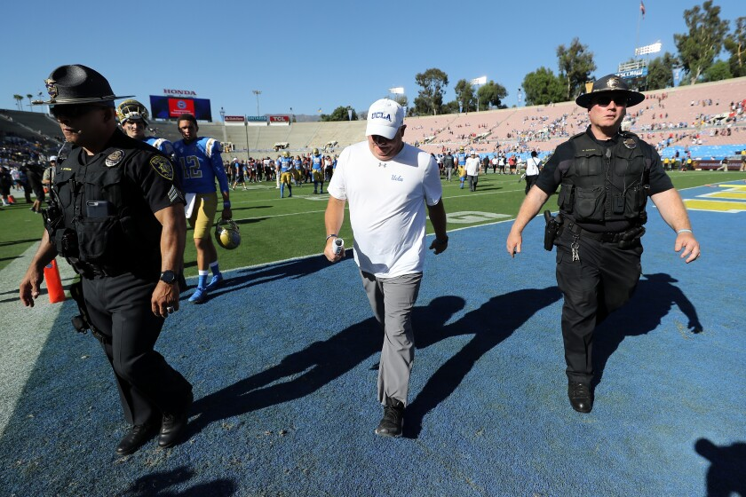 UCLA coach Chip Kelly walks off the field following Saturday's loss to San Diego State at the Rose Bowl.