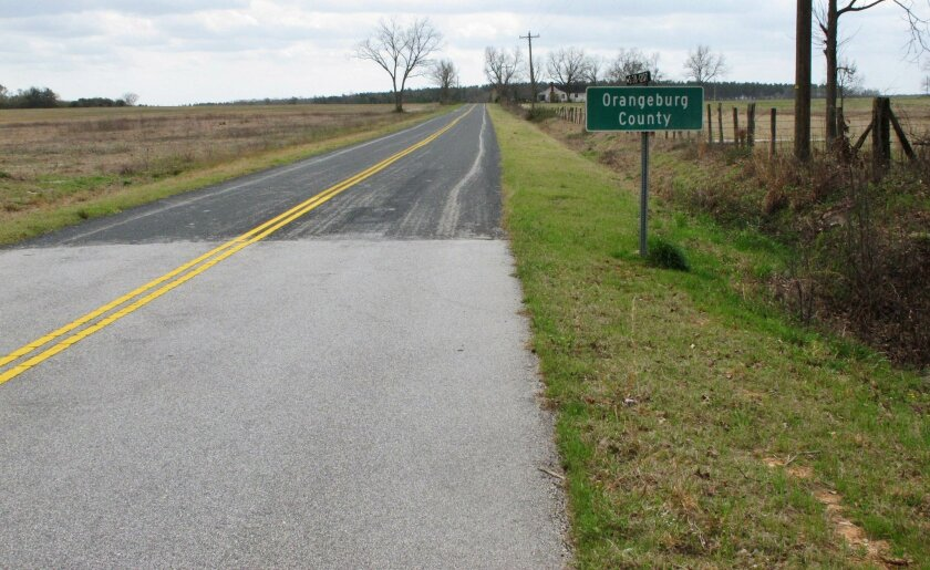 This Friday, March 11, 2016 photo shows the Williamson-Johnson Road at the Orangeburg-Aiken county line in Salley, S.C. Transportation officials say 46 percent of the pavement on South Carolina's state roads are in poor condition. (AP Photo/Jeffrey Collins)