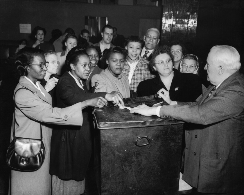 Black women voters at a polling station in Pittsburgh, 1950.