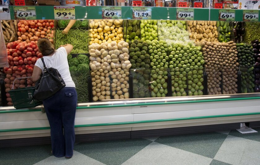 A customer shops for produce at a Vallarta Supermarket in National City.