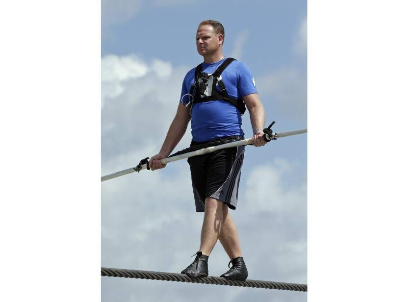 FILE - In this June 18, 2013 file photo, high wire performer Nik Wallenda practices in Sarasota, Fla. Wallenda will traverse the Masaya Volcano in Nicaragua on Wednesday, March 4, 2020. (AP Photo/Chris O'Meara, File)