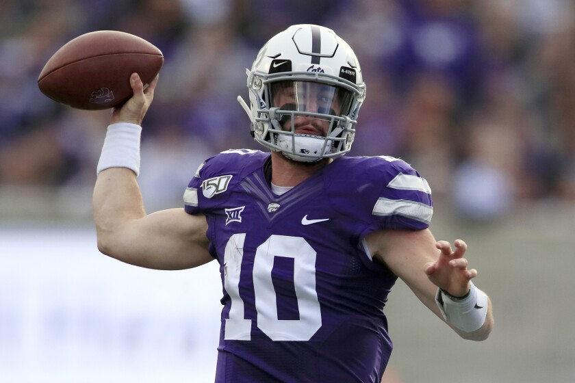 FILE - In this Nov. 16, 2019, file photo, Kansas State quarterback Skylar Thompson (10) passes to a teammate during the first half of an NCAA college football game against West Virginia in Manhattan, Kan. Thompson is back to direct the offense heading into the opener Sept. 12, 2020, against Arkansas State. (AP Photo/Orlin Wagner, File)