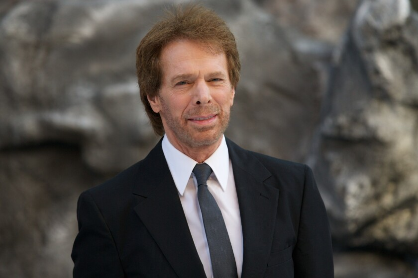 """Jerry Bruckheimer poses for pictures at the UK premiere of """"The Lone Ranger."""""""