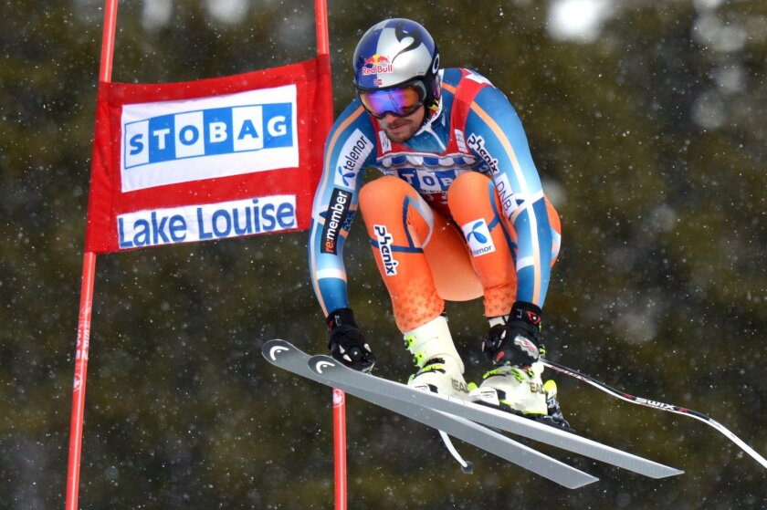 FILE - In this Nov. 30, 2013, file photo, Aksel Lund Svindal, of Norway, races during the men's World Cup downhill skiing competition in Lake Louise, Alberta. (AP Photo/The Canadian Press, Jonathan Hayward, File)
