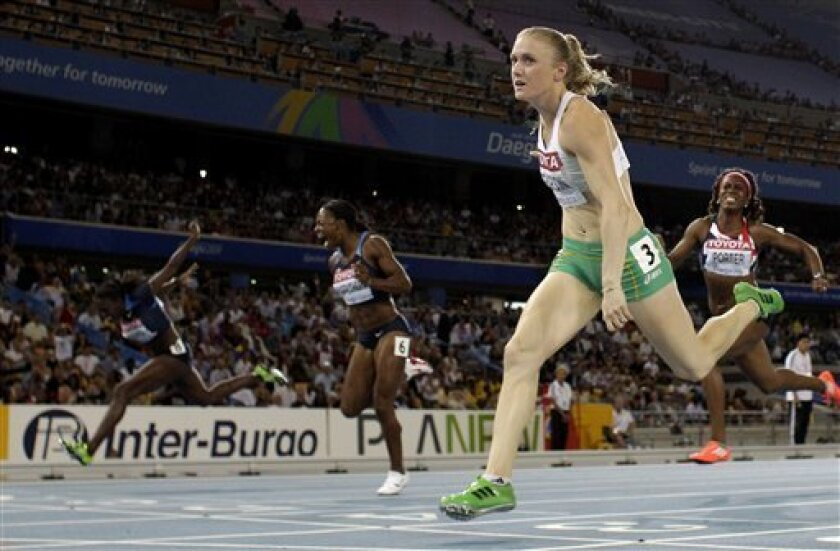 Australia's Sally Pearson crosses the finish line to win in the Women's 100m Hurdles final at the World Athletics Championships in Daegu, South Korea, Saturday, Sept. 3, 2011. (AP Photo/David J. Phillip)
