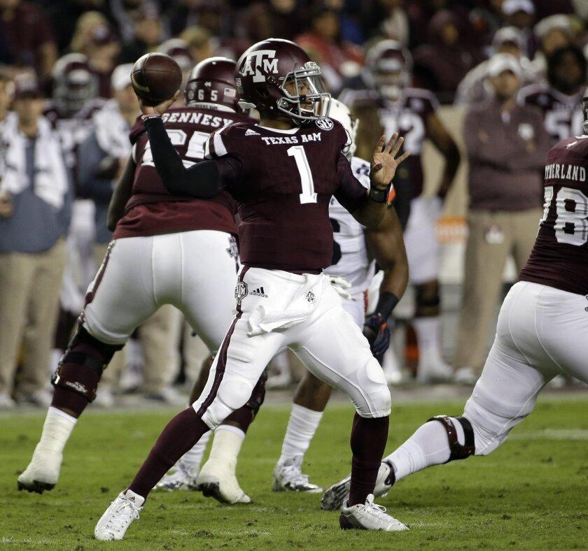 Texas A&M quarterback Kyler Murray (1) throws a pass against Auburn during the first quarter of an NCAA college football game, Saturday, Nov. 7, 2015, in College Station, Texas. (AP Photo/David J. Phillip)