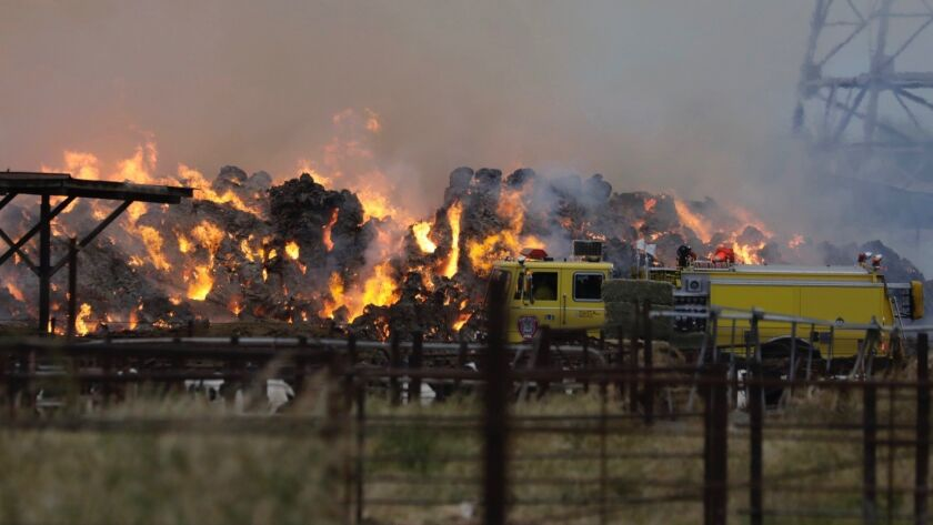 CHINO CA MAY 8, 2019 - Firefighters on Wednesday, May 8, 2019, continued to battle a massive hay fi