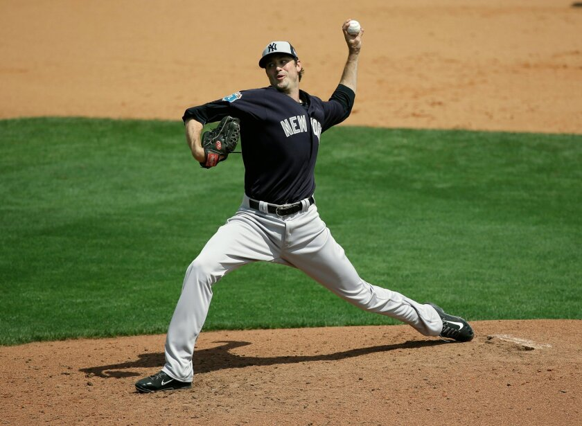New York Yankees' Andrew Miller pitches against the Atlanta Braves in a spring training baseball game, Wednesday, March 30, 2016, in Kissimmee, Fla. Miller was struck on the right arm by a line drive after the pitch, forcing the left-handed reliever to leave the game. (AP Photo/John Raoux)