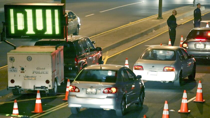 Cars line up at a DUI checkpoint on Los Feliz Blvd. at San Fernando Rd. on Friday, January 2, 2009.