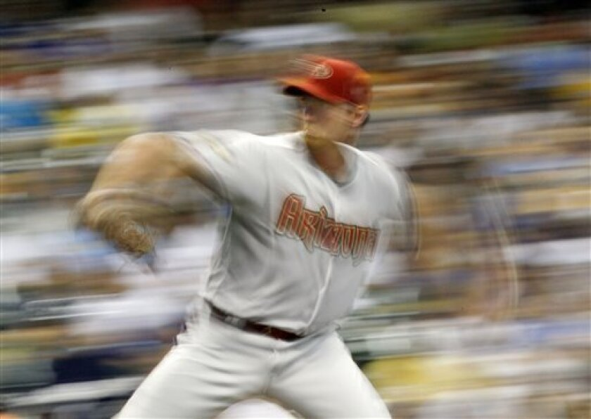 Arizona Diamondbacks starting pitcher Zach Duke throws against the Milwaukee Brewers in the fifth inning of a baseball game Tuesday, July 5, 2011, in Milwaukee. Image made with a slow shutter speed. (AP Photo/Jeffrey Phelps)