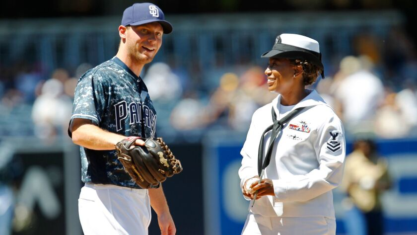 Padres pitcher Robbie Erlin greeted E5 Tiara Moore on the mound on Military Opening Day at Petco Park before a Padres-Diamondbacks game.