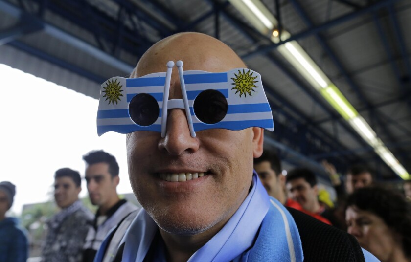 Sunglasses can be fun. Here a soccer fan sports a pair of Uruguayan flag-designed sunglasses as he attends a World Cup soccer match between Uruguay and England in Sao Paulo, Brazil.