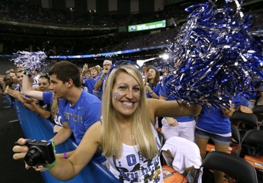 A Kentucky fan cheers before an NCAA Final Four semifinal college basketball tournament game between Kentucky and Louisville Saturday, March 31, 2012, in New Orleans. (AP Photo/David J. Phillip)