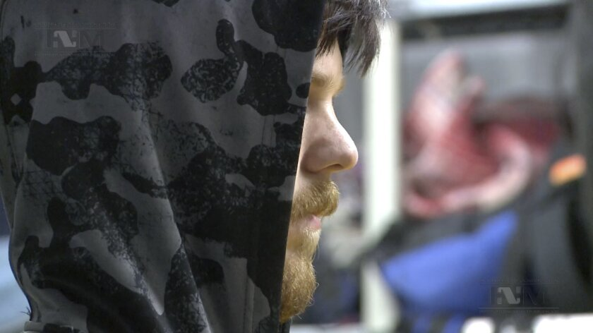 """This frame grab from a Thursday, Jan. 28, 2016 taken from a video provided by Mexico's Instituto Nacional de Migracion, INM, shows a hooded Ethan Couch, as he is processed by Mexican immigration agents, in Mexico City. INM said that Couch, who used an """"affluenza"""" defense in a 2013 fatal drunken-driving accident in Texas, was taken to the Mexico City airport from an immigration holding center, ending his month-long stay in Mexico. Couch was escorted onto a commercial plane, en route to Dallas, Thursday morning. (Instituto Nacional de Migracion, INM via AP)"""