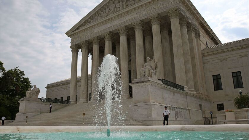 The U.S. Supreme Court in Washington. The justices wiped away lower court rulings that supported a young detained immigrant's right to obtain an abortion.