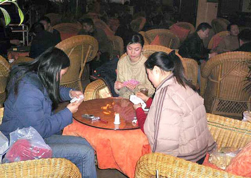 """LEISURE WORLD: Unlike people in other cities, where the frantic pace of China's boom is evident, """"in Chengdu, their attitude is to get to the teahouses as soon as possible,"""" says an American expatriate. Above, customers relax at Datang, one of the city's 4,000 teahouses."""