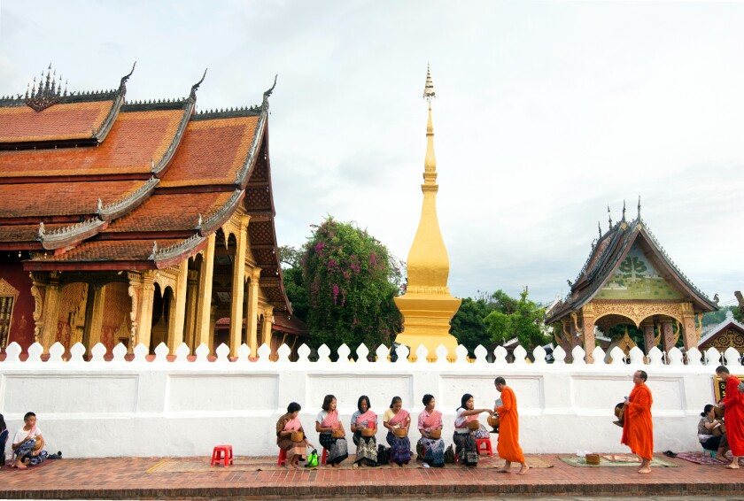 Monks on their morning alms round in Luang Prabang, Laos