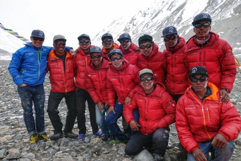 In this undated photo provided by Alpenglow Expeditions, Brian Warren, a guide with Alpenglow Expeditions, far left, poses for a photo with a group of Sherpas at a Mount Everest base camp on the northern Tibetan side of the mountain. The abrupt ending of the climbing season on Mount Everest's north