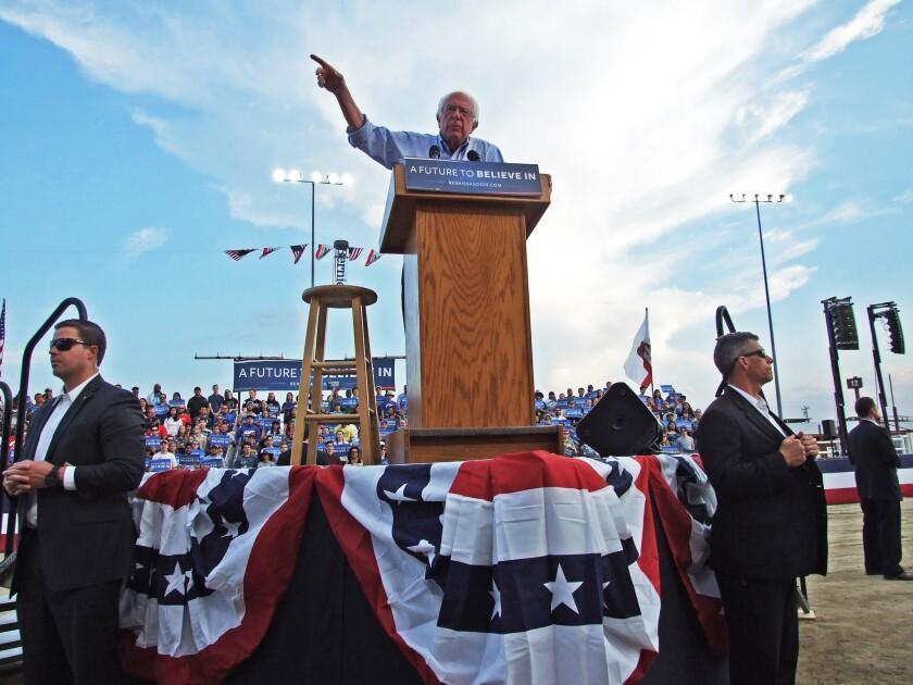 Bernie Sanders speaks to a crowd at the Kern County fairgrounds in Bakersfield.