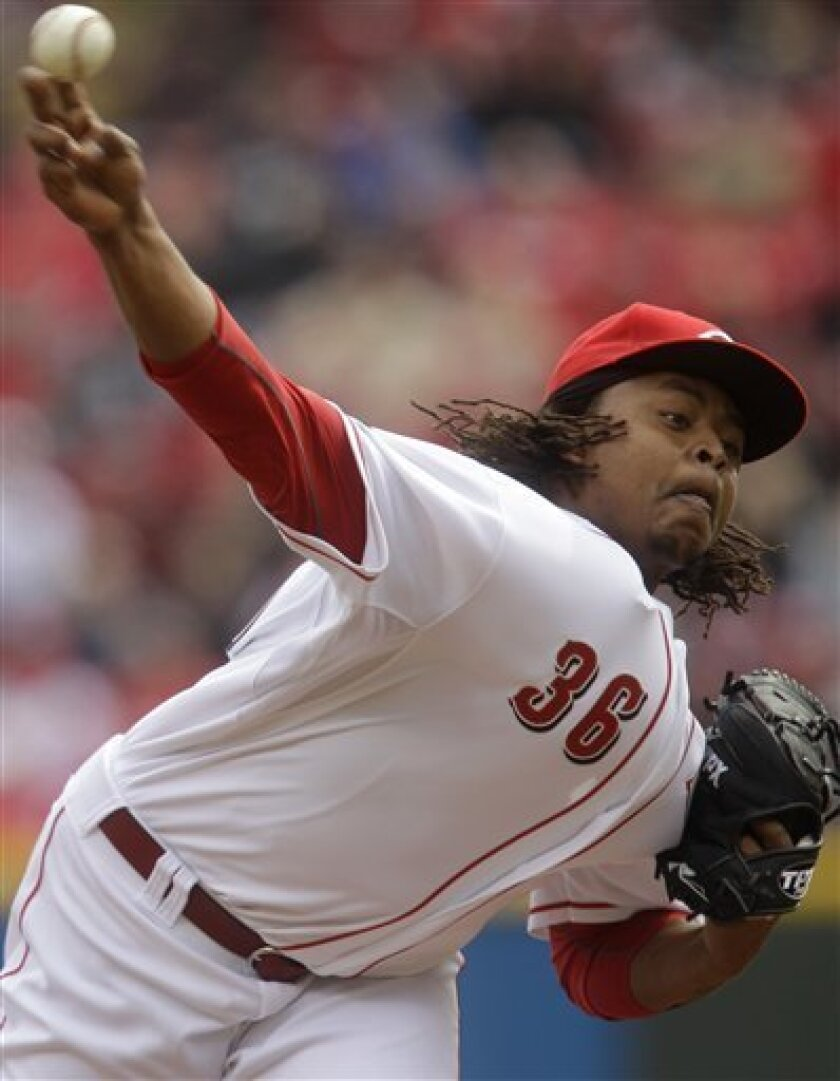Cincinnati Reds starting pitcher Edinson Volquez throws against the Milwaukee Brewers during the first inning of an opening day baseball game, Thursday, March 31, 2011 in Cincinnati. (AP Photo/Al Behrman)