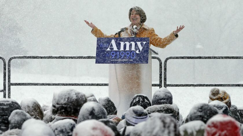 Sen. Amy Klobuchar (D-Minn.) addresses the crowd at a snowy rally where she announced she is entering the race for her party's presidential nomination Sunday.
