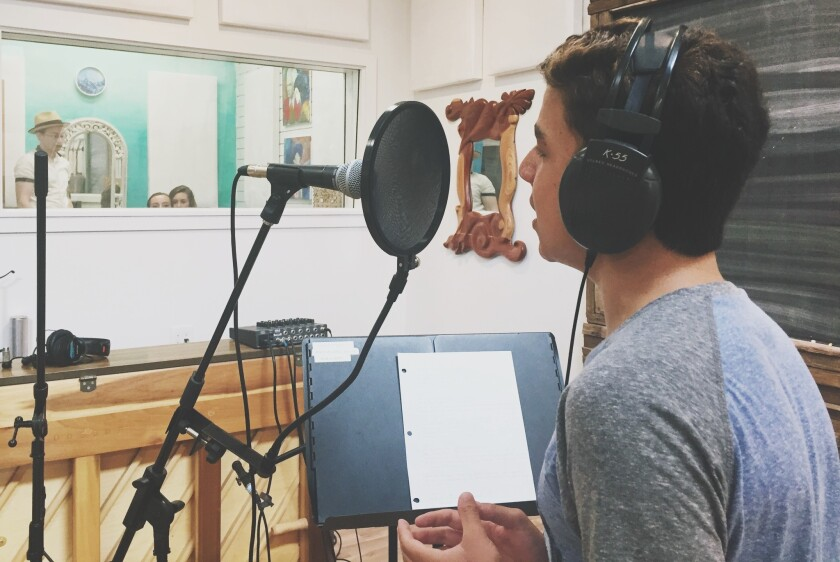 Jack Rickard (aka Jack Taylor) records vocals for his original song in the Kalabash studio during the last summer camp.