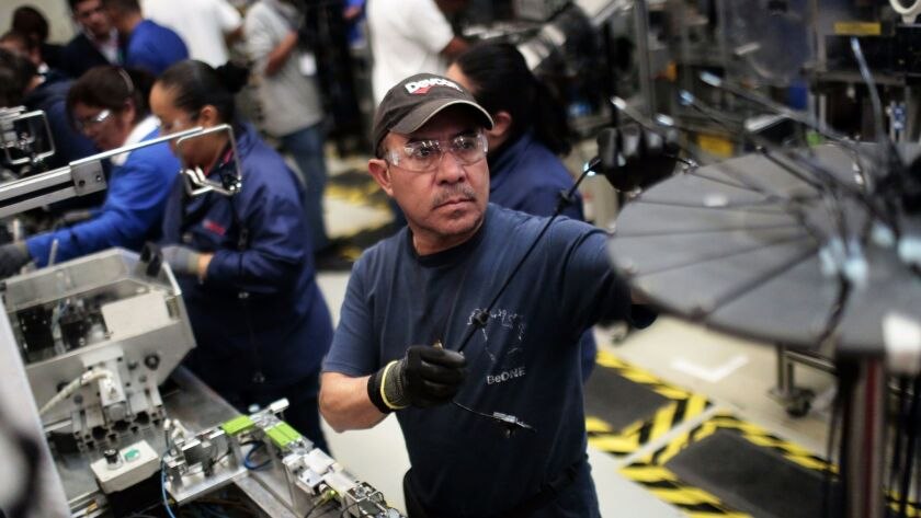 A worker in the auto parts production line at the Bosch factory in San Luis Potosi, Mexico.