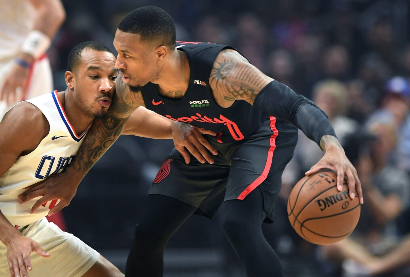 Clippers guard Avery Bradley defends Trailblazers guard Damian Lillard in the 1st quarter at the Staples Center on Monday.