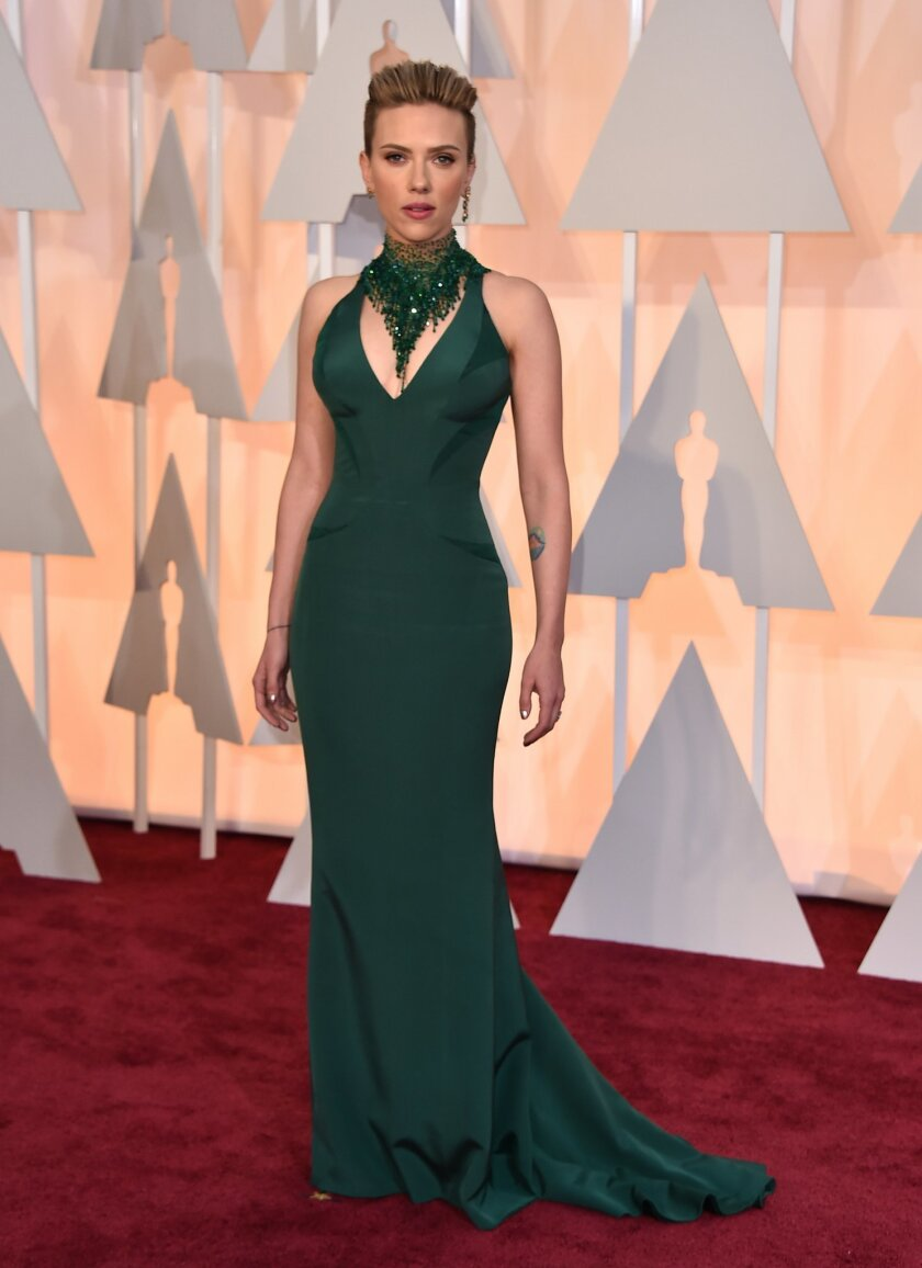 Scarlett Johansson arrives at the Oscars on Sunday, Feb. 22, 2015, at the Dolby Theatre in Los Angeles. (Photo by Jordan Strauss/Invision/AP)