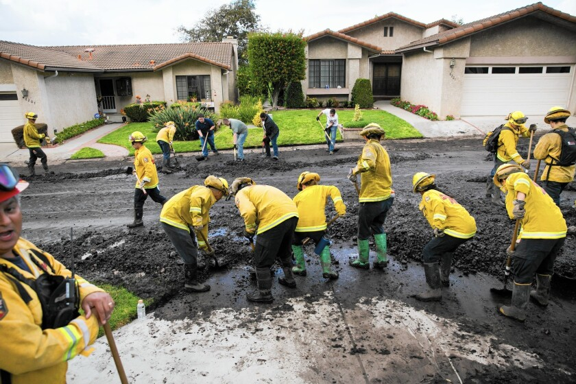 Ventura County firefighters clear the road after a mudslide in Camarillo. Eleven homes were evacuated and 20 people displaced for a few hours early on Nov. 1.