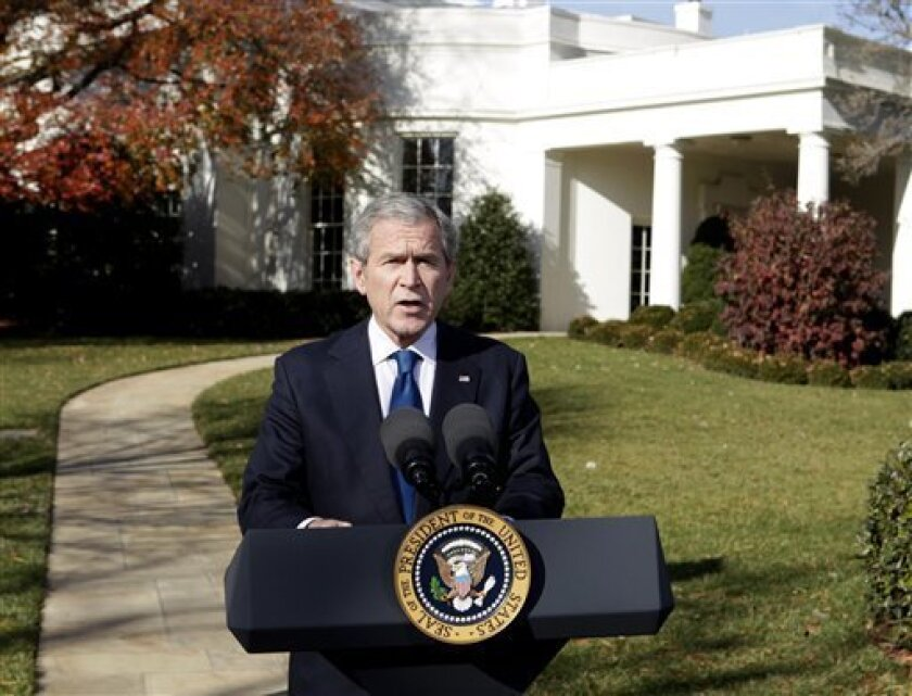 President George W. Bush makes a statement on the economy, Friday, Dec. 5, 2008, on the South Lawn of the White House in Washington. (AP Photo/Evan Vucci)