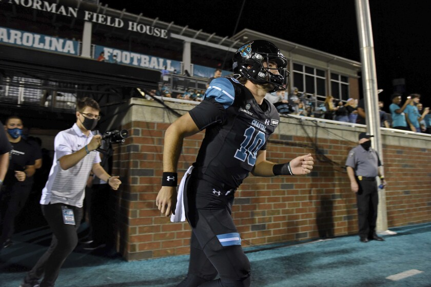 Coastal Carolina quarterback Grayson McCall runs to take the field before an NCAA college football game against South Alabama, Saturday, Nov. 7, 2020, in Conway, S.C. (AP Photo/Richard Shiro)