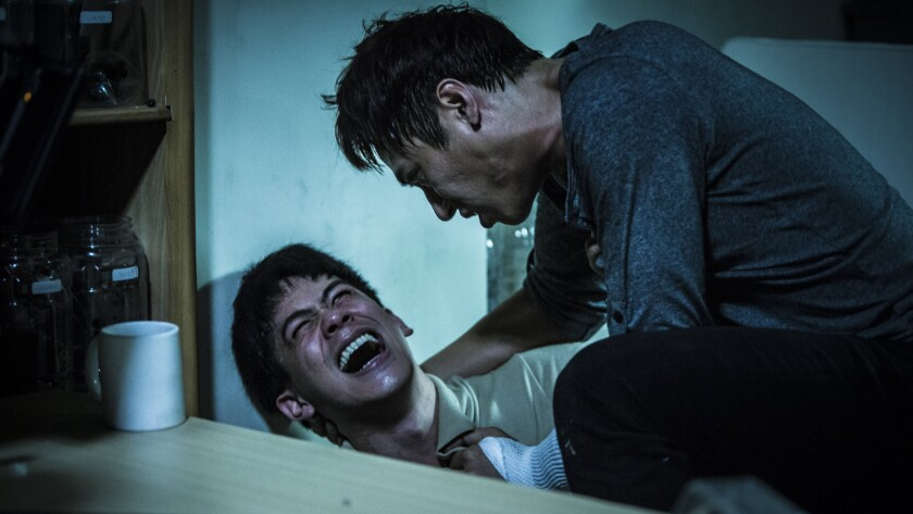 """(L-R) - Mason Lee and Kaiser Chuang in a scene from """"Who Killed Cock Robin?"""" Credit: Cheng Cheng Fil"""